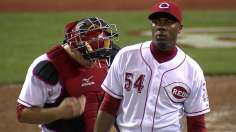 Reds hang on after offense's early eruption