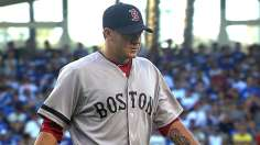 Peavy's three-hitter puts Red Sox alone in first