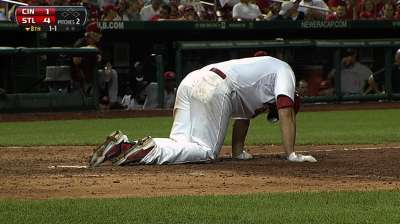 Cardinals' win no picnic for beat-up Holliday
