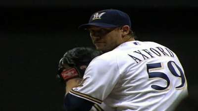 Brewers trade Axford to Cards for player to be named