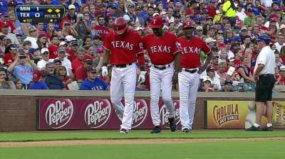 Andrus sits with stiff lower back