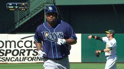 Delmon adjusts quickly at plate, in clubhouse
