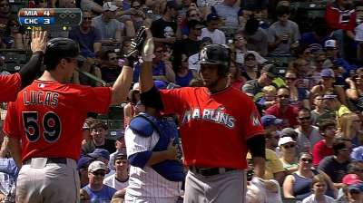 Alvarez does it all for Marlins in Labor Day win