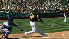 A's beat Darvish again, rejoin Rangers atop AL West