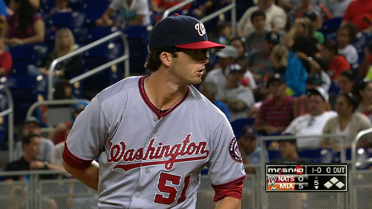 Elbow soreness prompts Nats to put Davis on DL