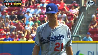 Dodgers fall on walk-off single in extras
