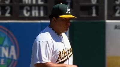 A's unleash seven-run inning to back Colon