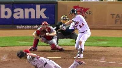 Plouffe's three RBIs help Twins end home skid