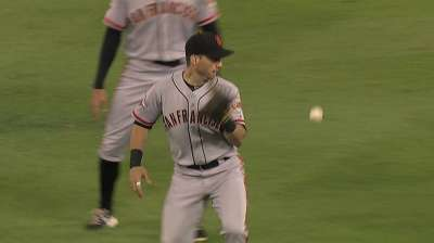 Giants pull Scutaro with stiff back