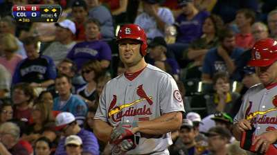 Holliday's big night lifts Cardinals into first place
