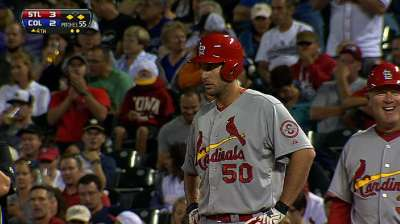 Cards hold off Rockies to extend division lead