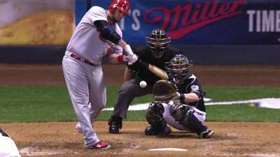 Cards extend division lead with extra-inning win