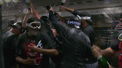 Braves earn division crown, then boost NL-best mark