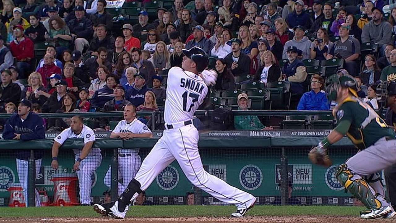 Smoak, Morrison exchange figures with Mariners