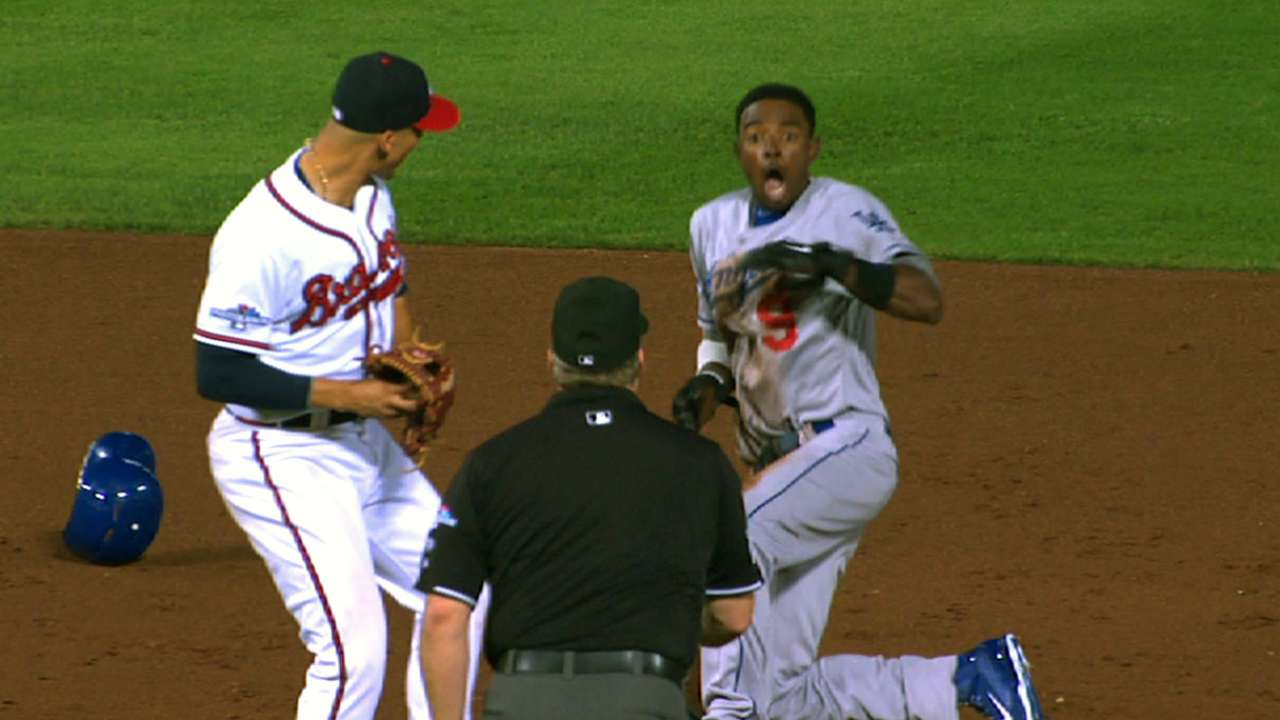 Braves' young backstops following Laird's lead