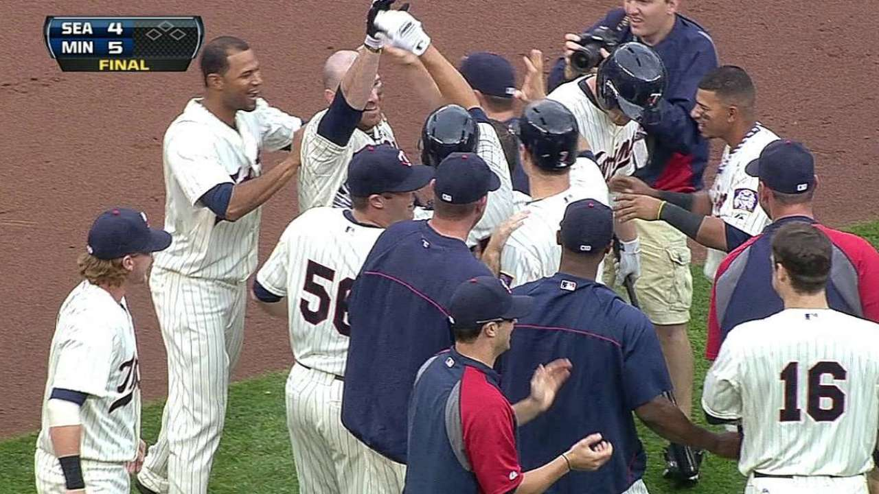 Doumit's two-run triple wins it for Twins