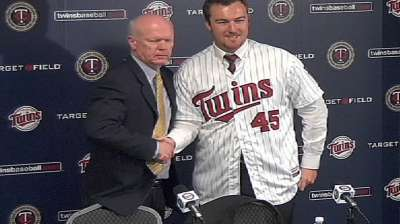 Twins introduce Hughes after completing deal