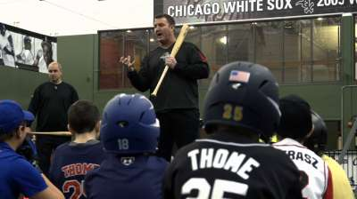 Thome lends insight to kids at hitting clinic