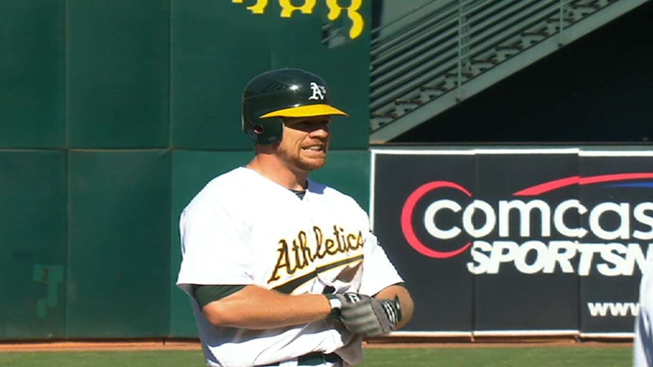 A's avoid arbitration, agree with Moss, Blevins