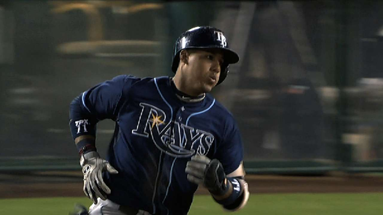 Feeling at home, Escobar reports to Rays camp