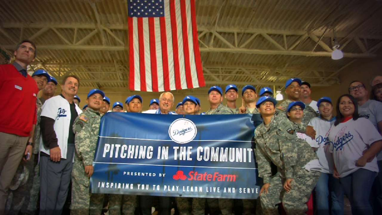 Dodgers players help community to end caravan