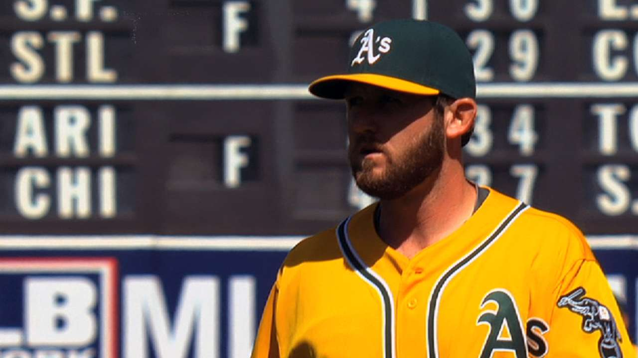 Out all of spring, Cook rejoins A's bullpen