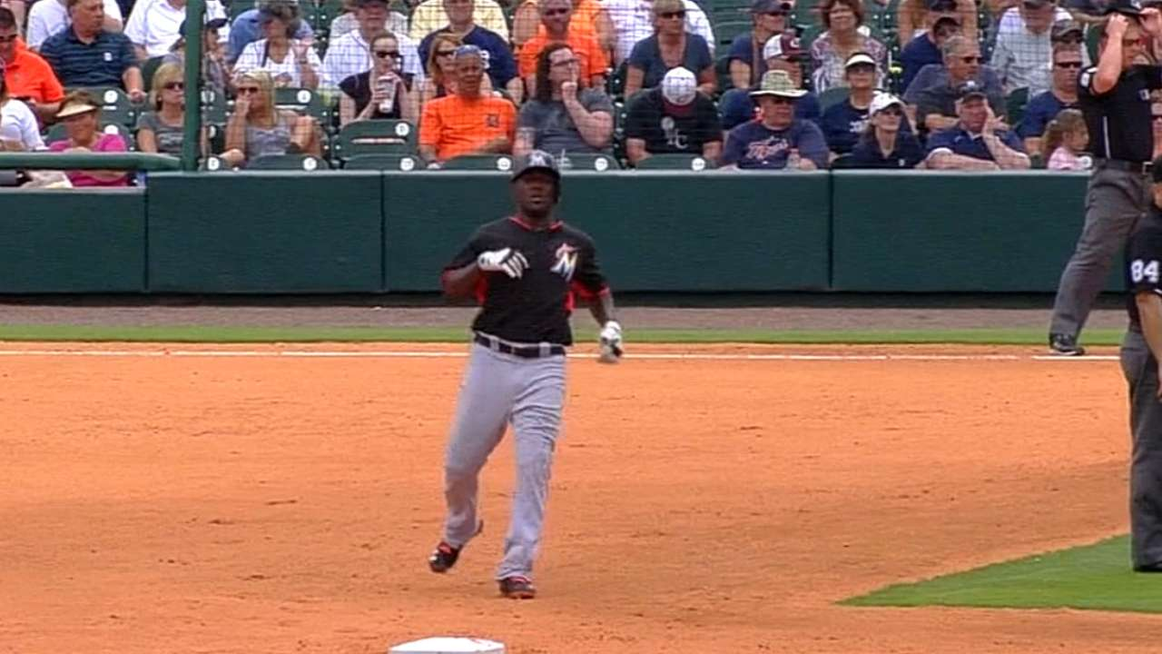 While competing for roster spot, Ozuna sustains cramp