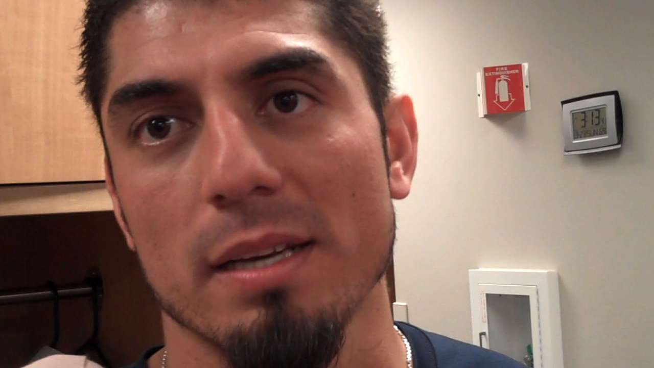 Garza dismisses 'struggles,' cruises against Reds