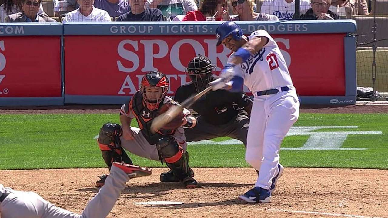Kemp makes debut, but Puig still steals show