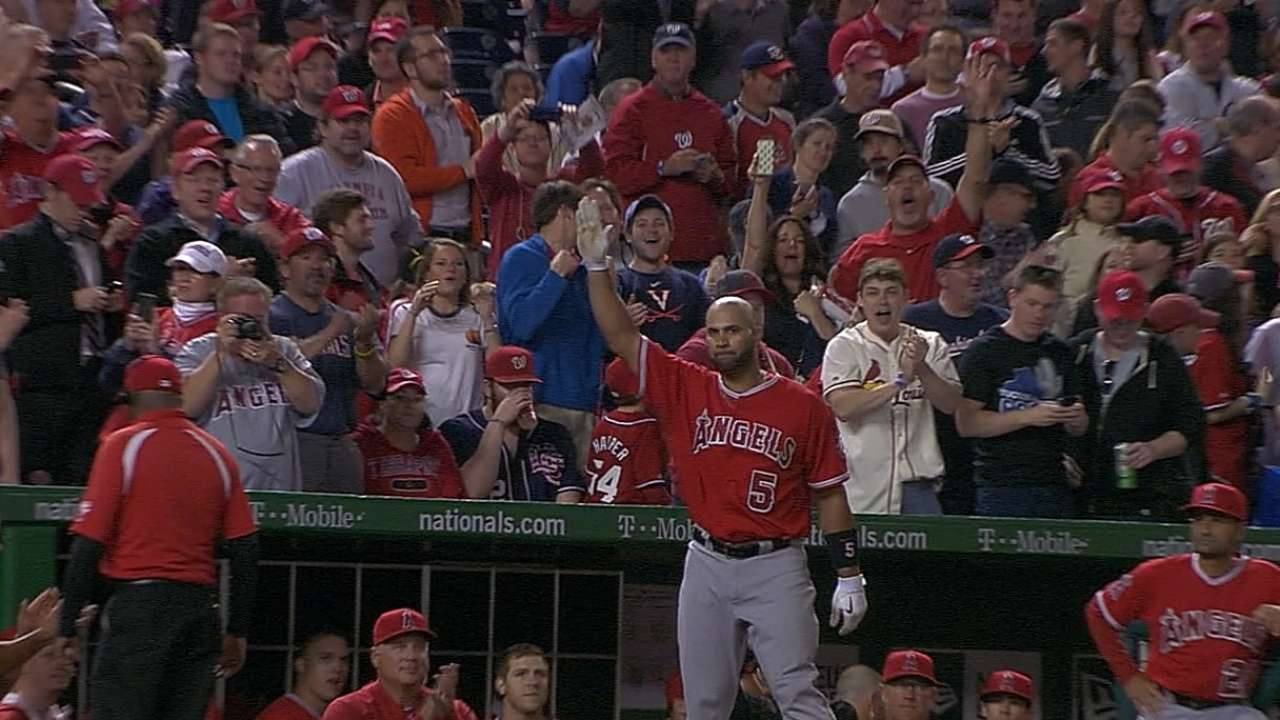 Pujols' milestone homer brings smiles to Cardinals
