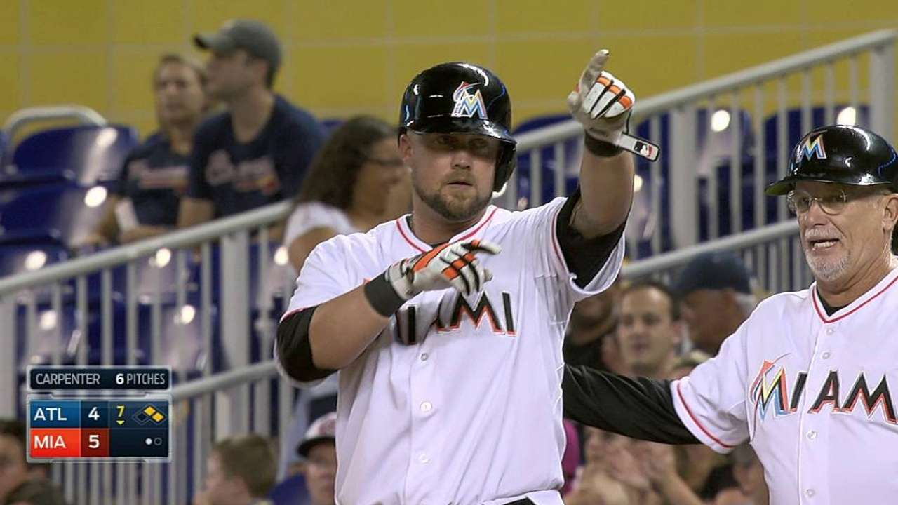 Marlins rally to finish sweep of Braves, reach .500
