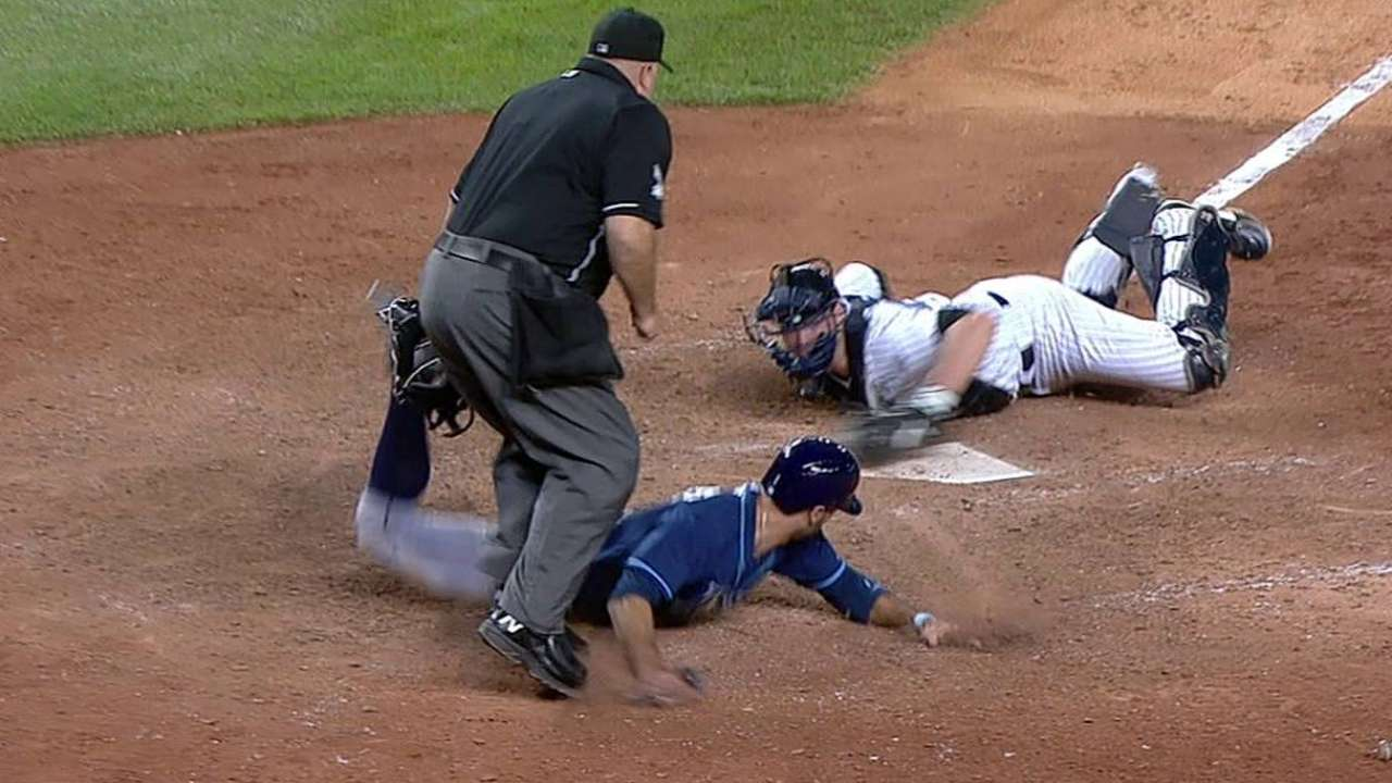 Pair of safe calls at first overturned in Rays-Yanks tilt