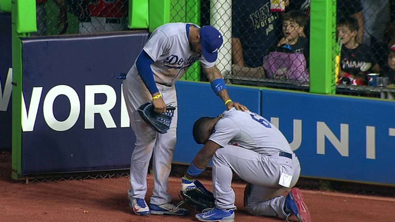 Puig out of lineup day after colliding with wall