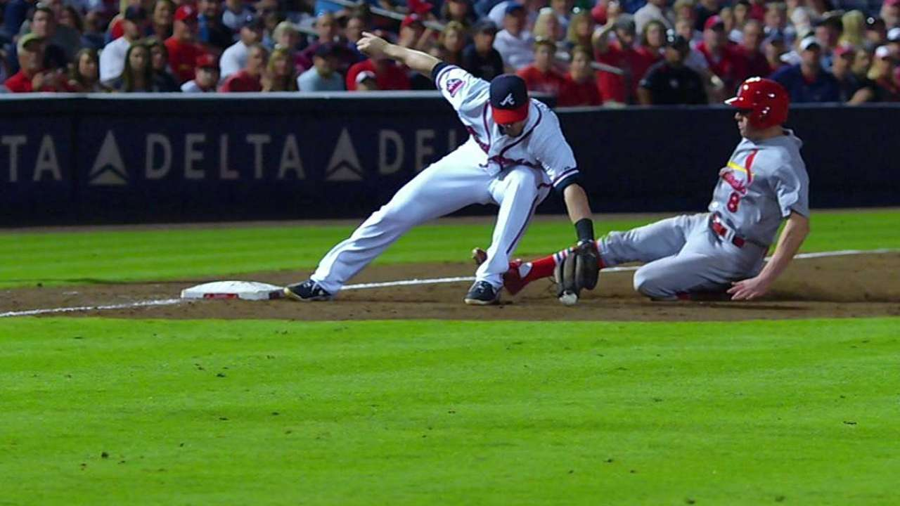 Braves challenge, get call overturned to save run