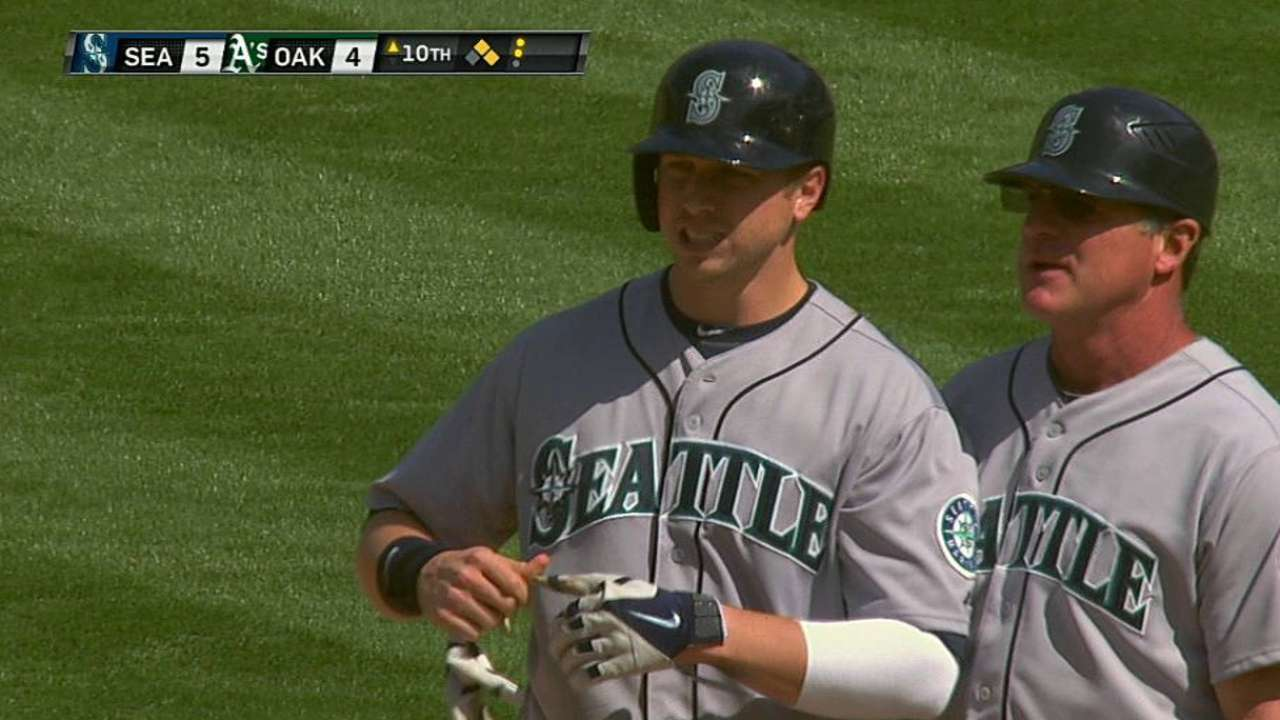 Mariners rally late, top A's in 10 in twin-bill opener