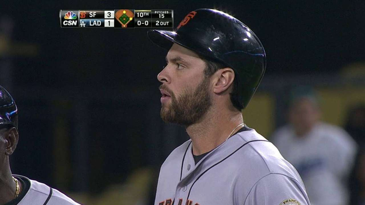 Giants' LA run continues with extra-inning win