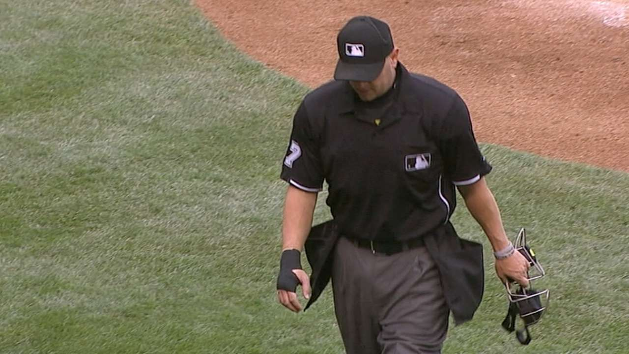 Plate umpire exits game with bruised hand