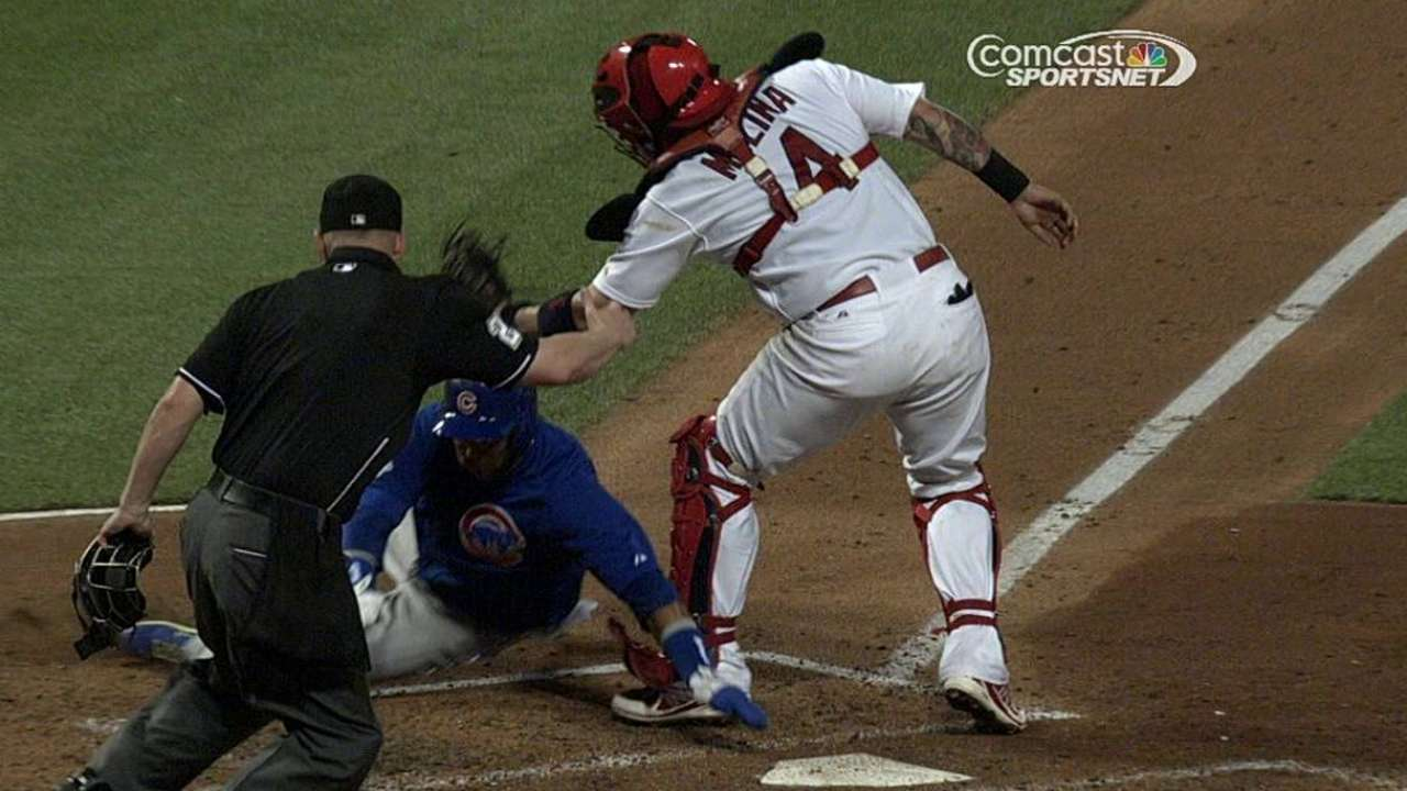 Cubs win challenge on play at plate, awarded run
