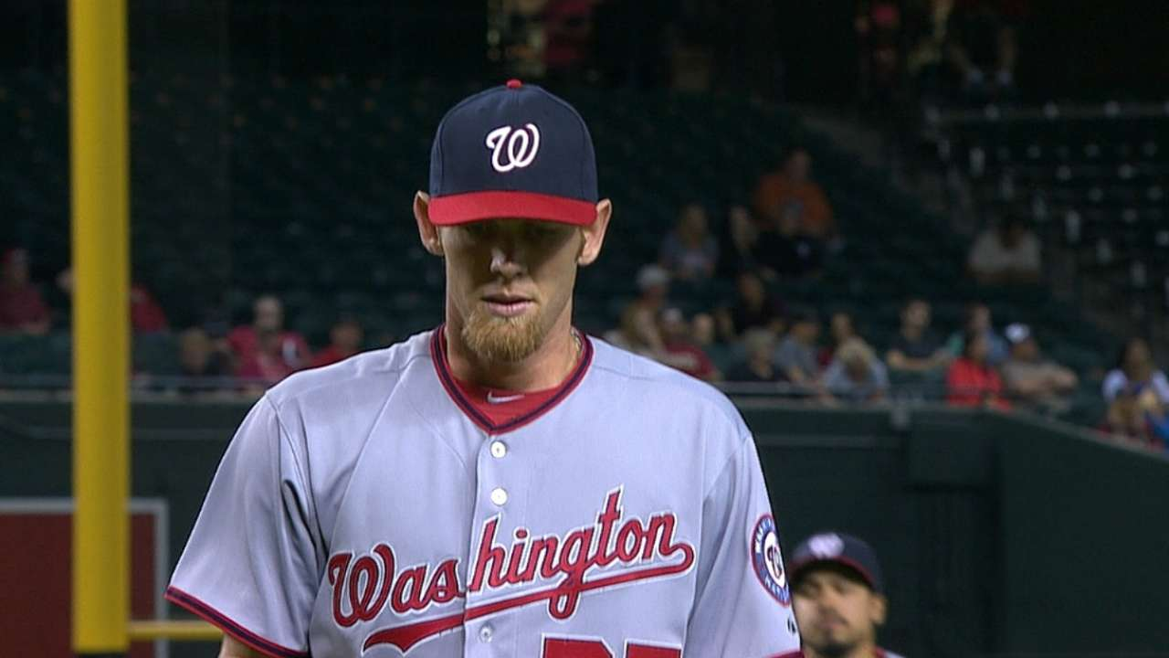 Strasburg gets outpitched by veteran Arroyo