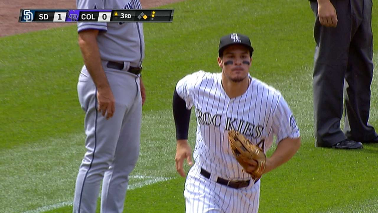 Interference call helps Rockies turn three