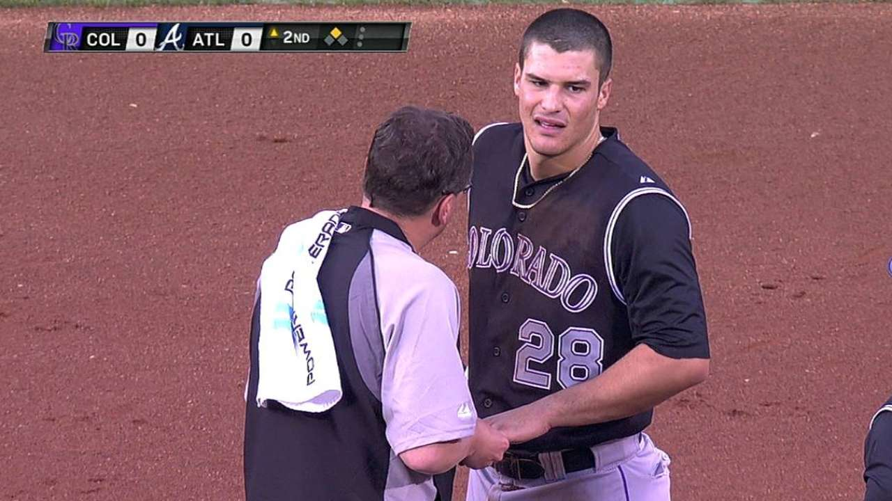Arenado breaks finger on headfirst slide, hits DL