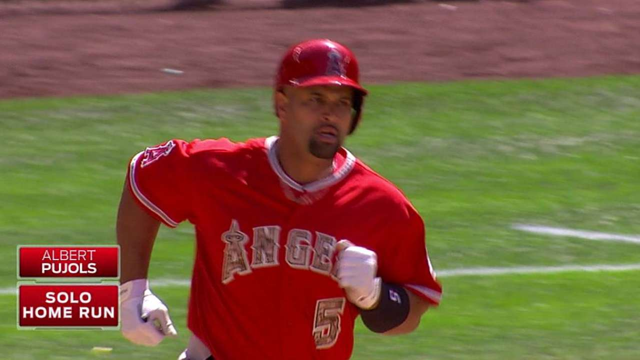 Pujols hits homer No. 506, but Angels fall in opener