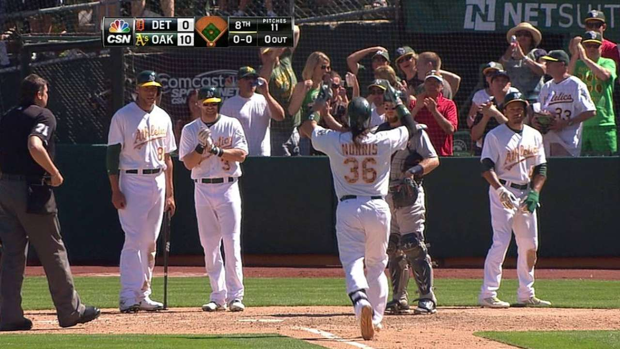 A's belt five homers to tame Tigers in shutout