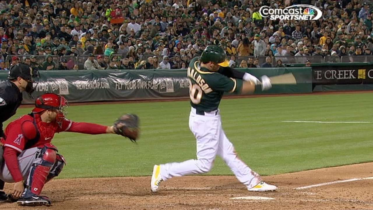 A's tee off for three homers, take opener of showdown
