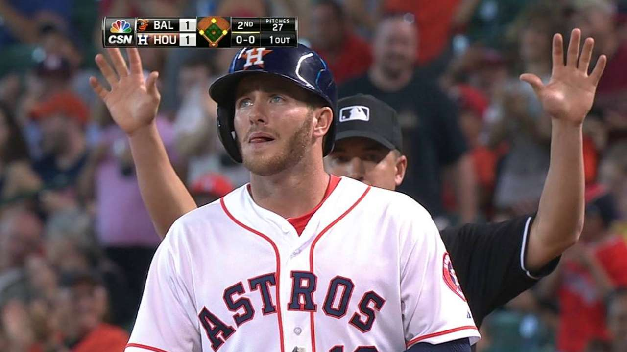 Free passes sting as Astros' win streak snapped
