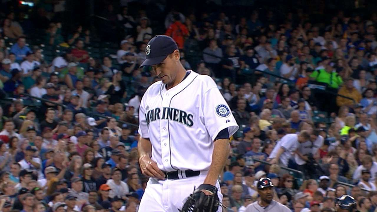Young, bullpen hold off Tigers at Safeco Field