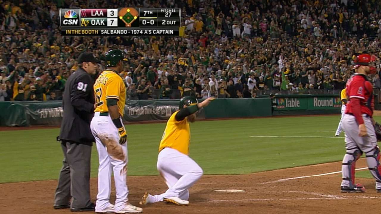 Cespedes helps A's charge past Angels