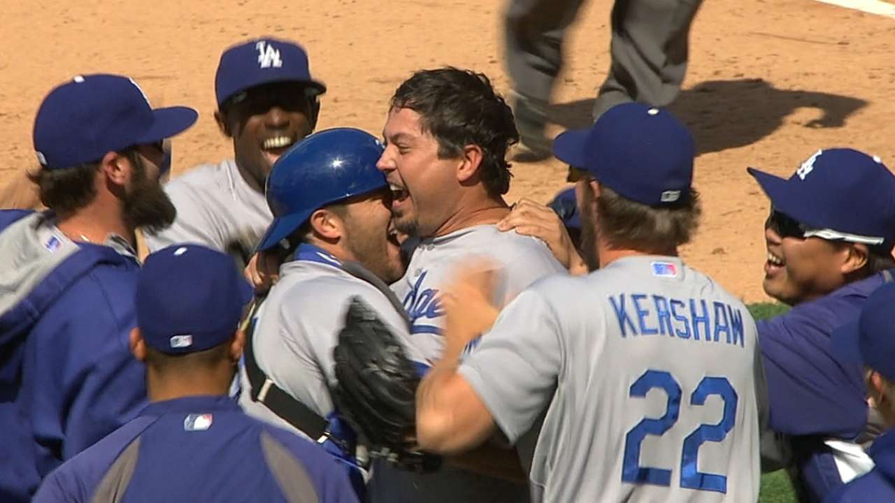 Teammates celebrate Beckett's accomplishment