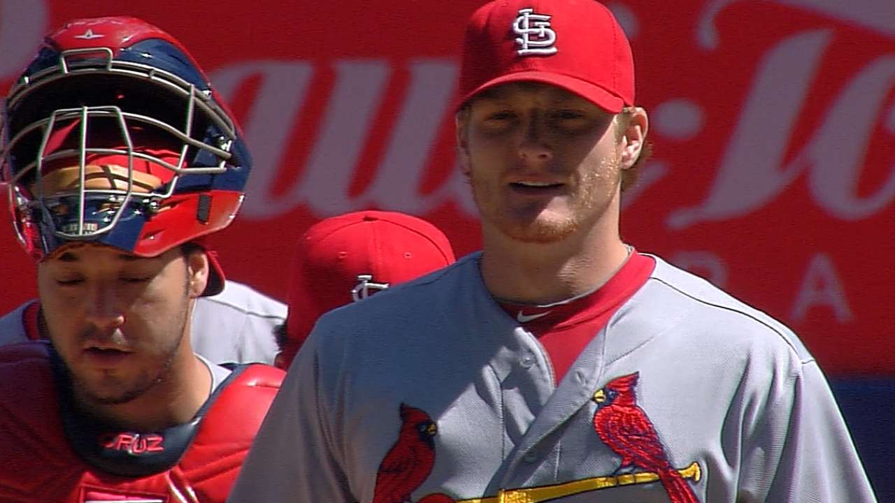 Cards ignite late as Miller shuts out Blue Jays