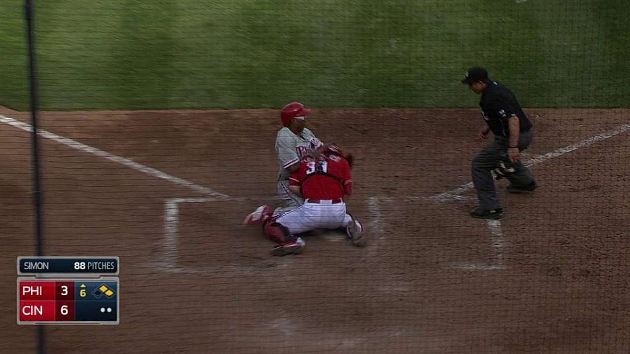 Play at plate confirmed by replay, looms large in Cincy